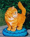 Free standing painting of a kitten, painted on wood.
